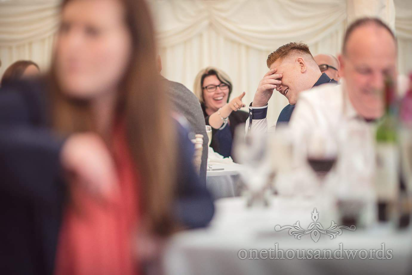 Embarrassed wedding guest holds his head in his hands at The Old Vicarage Wedding