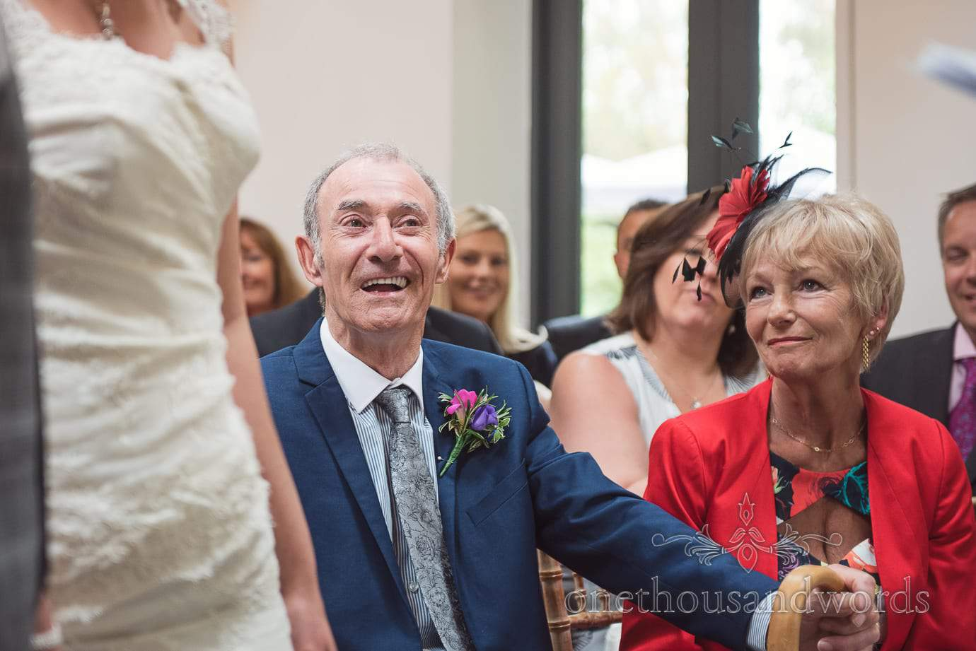 Father of the bride in blue suit laughs during The Old Vicarage Wedding ceremony