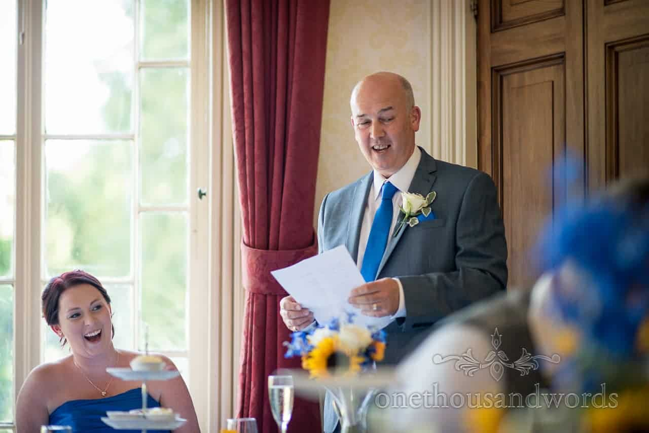 Father of the bride speech with blue wedding tie and white buttonhole at Upton House