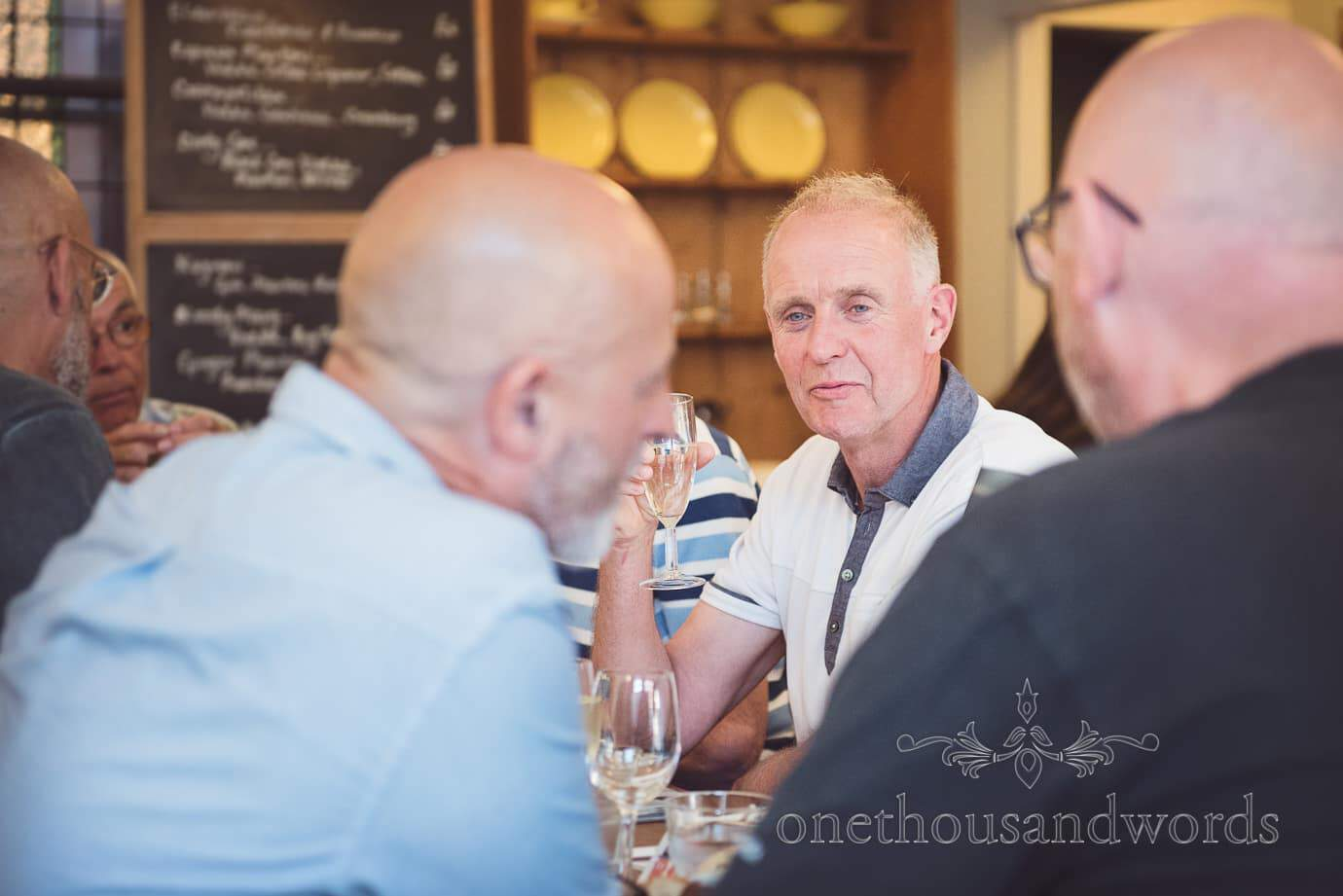 Father of the groom portrait photograph at pre-wedding meal in Swanage