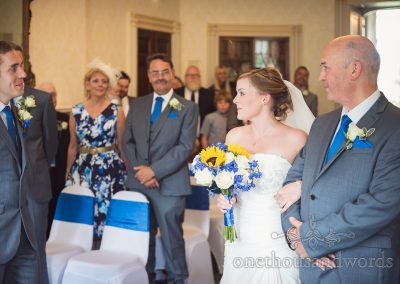 First look at blue and yellow themed wedding ceremony at Upton House wedding venue