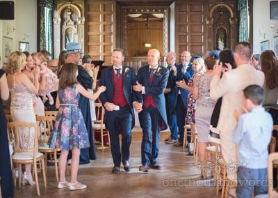 Gay wedding couple walk down the aisle together at Purbeck House Hotel wedding