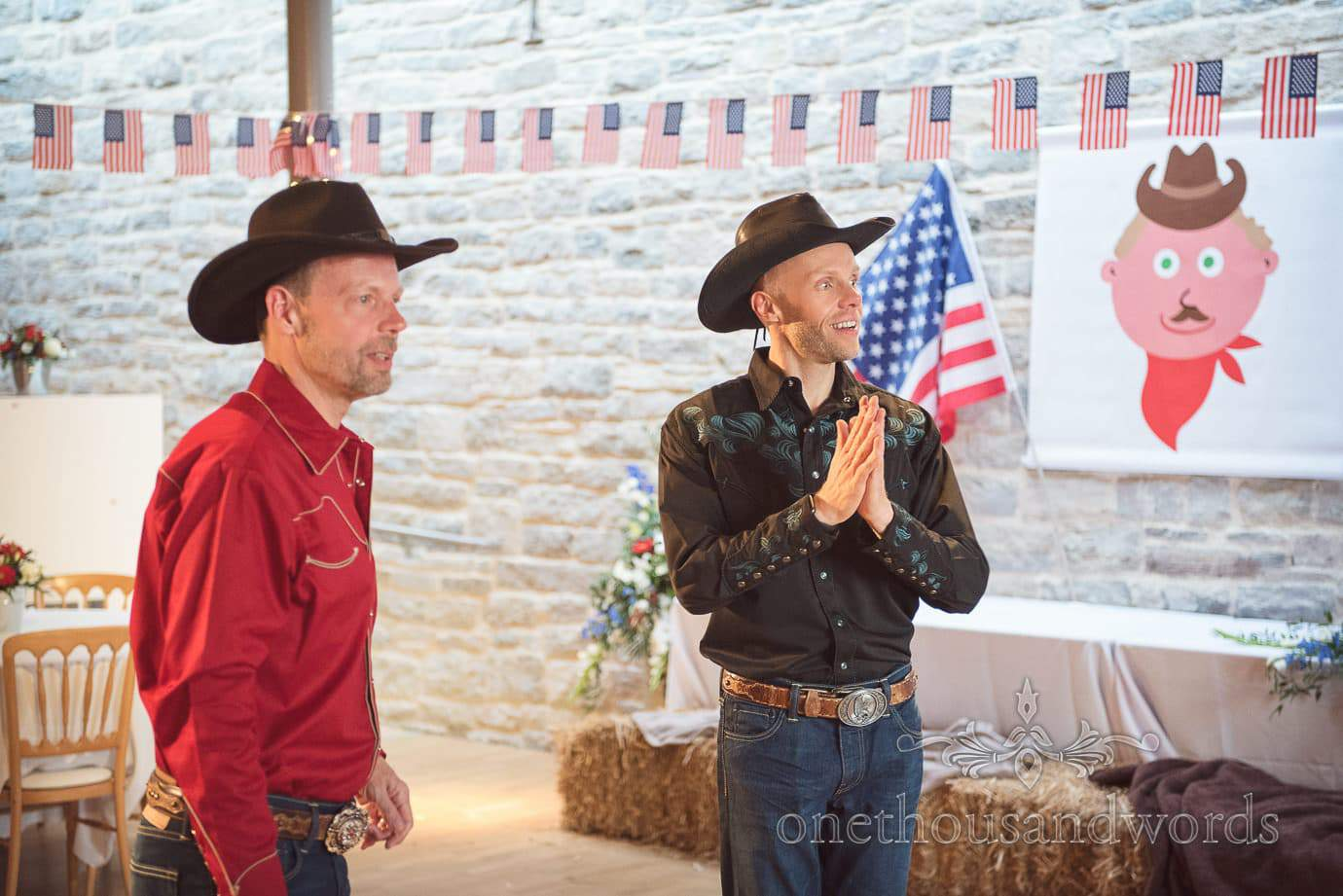 Gay wedding cowboy grooms at American themed barn dance wedding evening