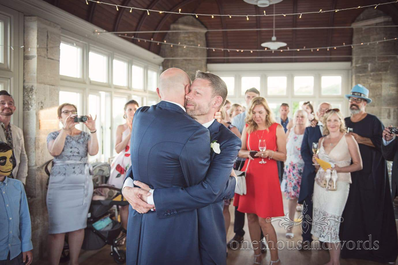 Gay wedding first dance at Durlston castle by Swanage wedding photographers