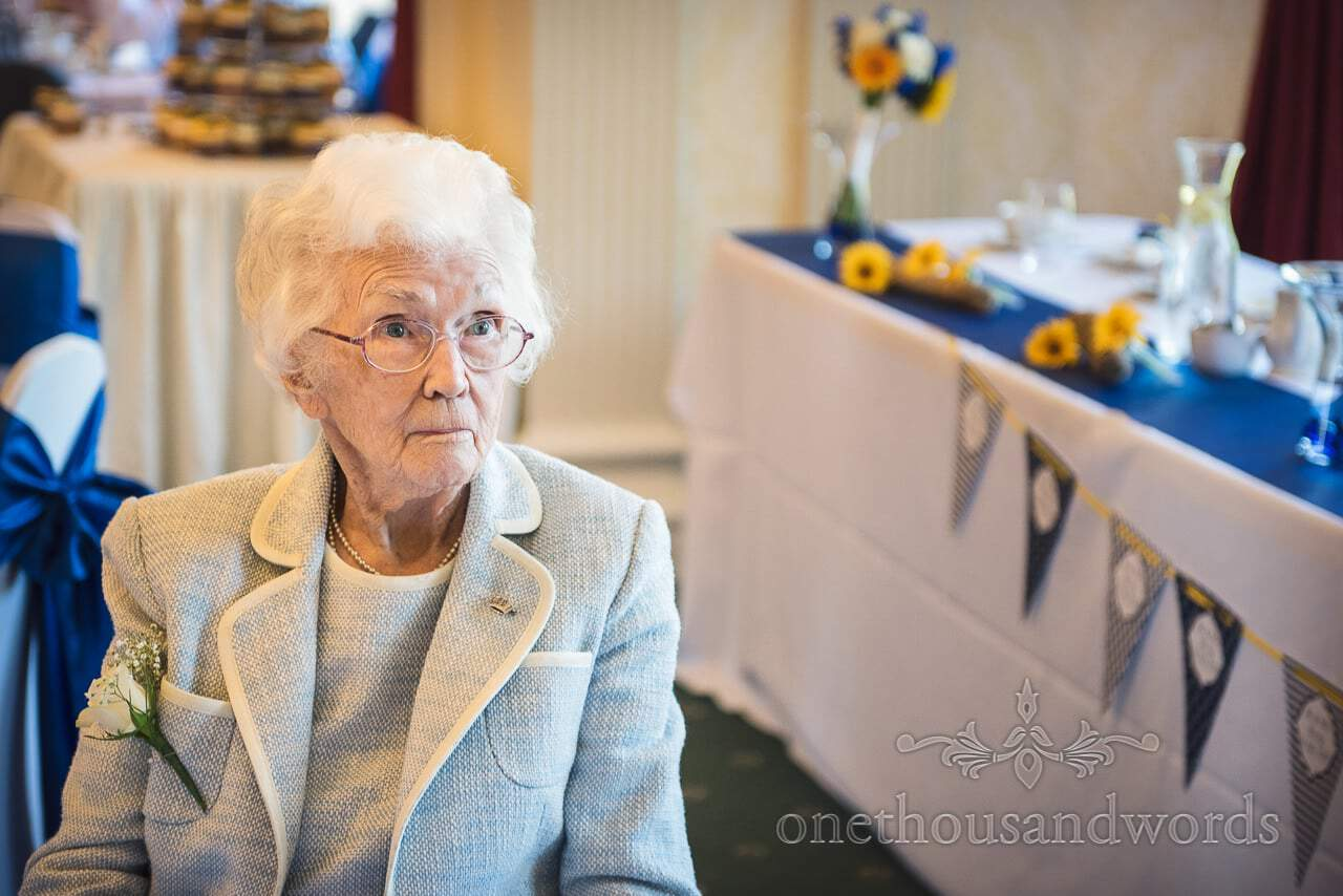 Grandmother of the bride at blue and yellow themed wedding at Upton House