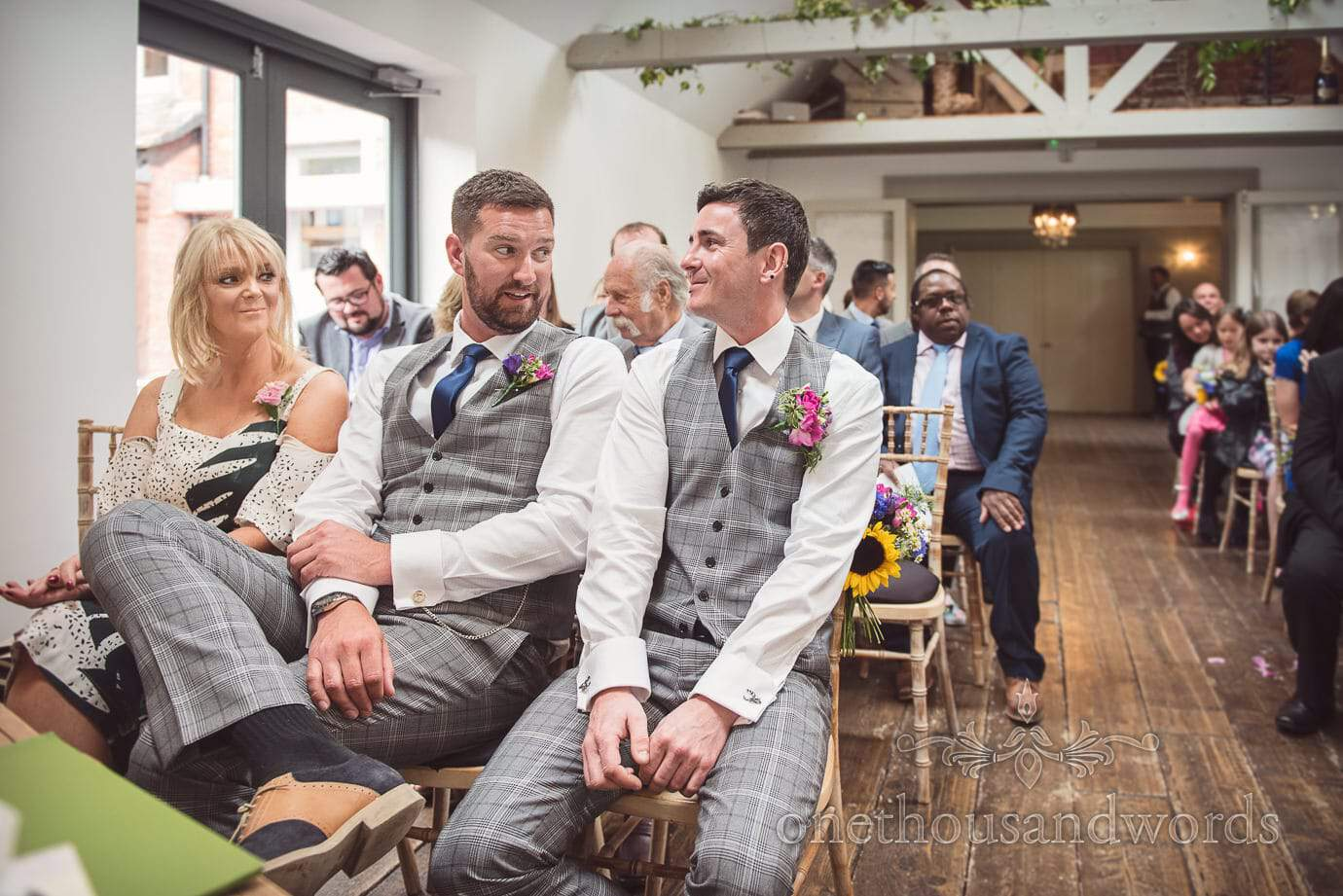 Groom and best man in grey check suits await bride at Old Vicarage orangery wedding venue