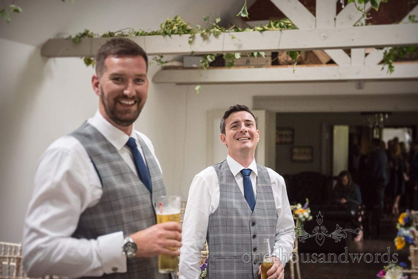 Groom and best man in grey check waistcoats and blue ties at The Old Vicarage