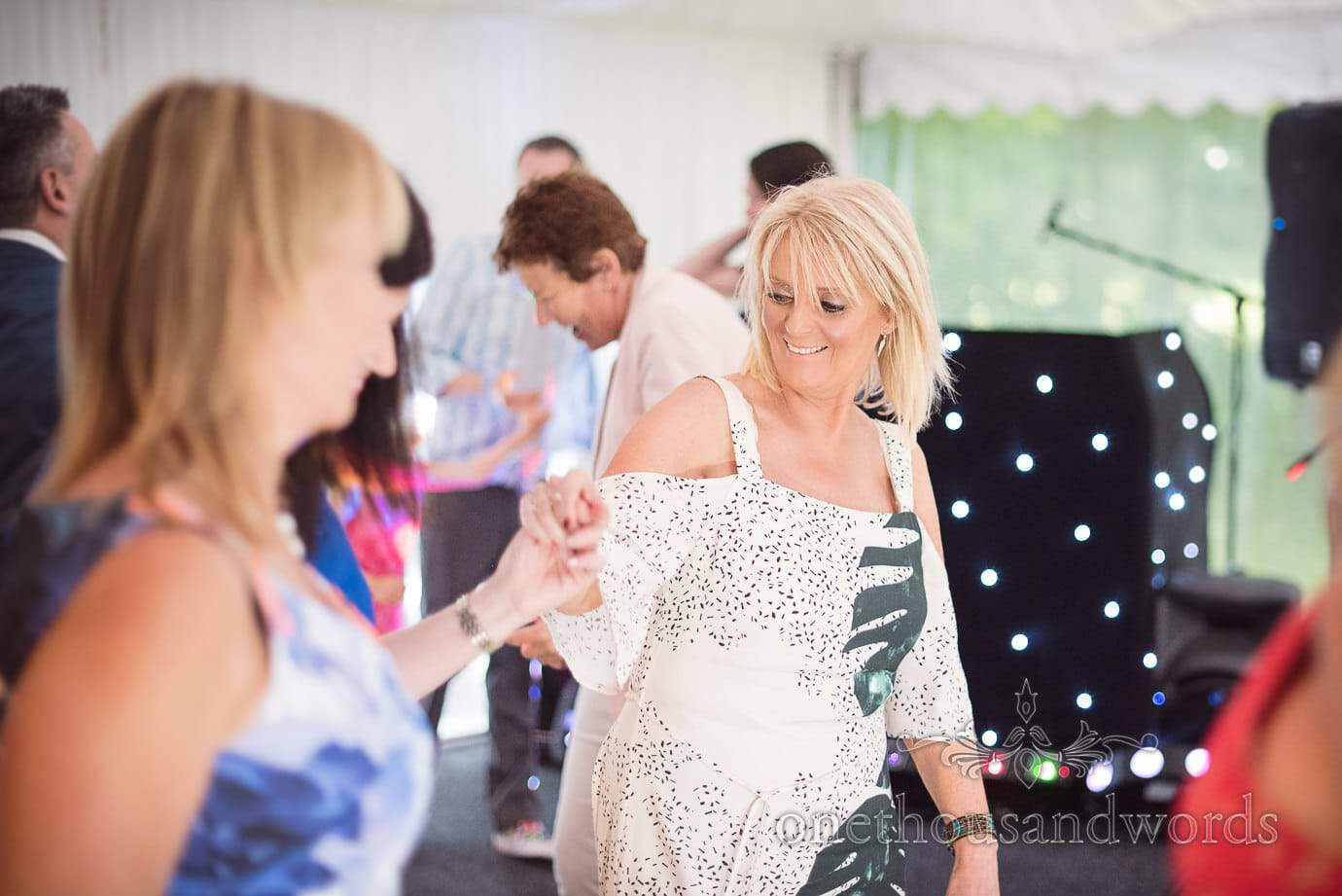 Groom's Mother in black and white leaf pattern dress dances at The Old Vicarage Wedding