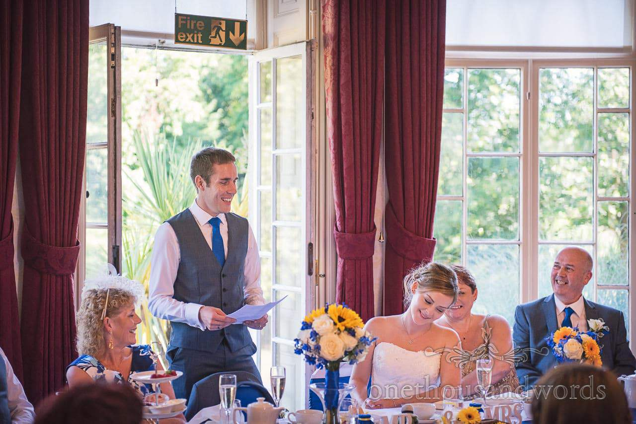 Groom's wedding speech at Upton House with blue and yellow flowers at Upton House