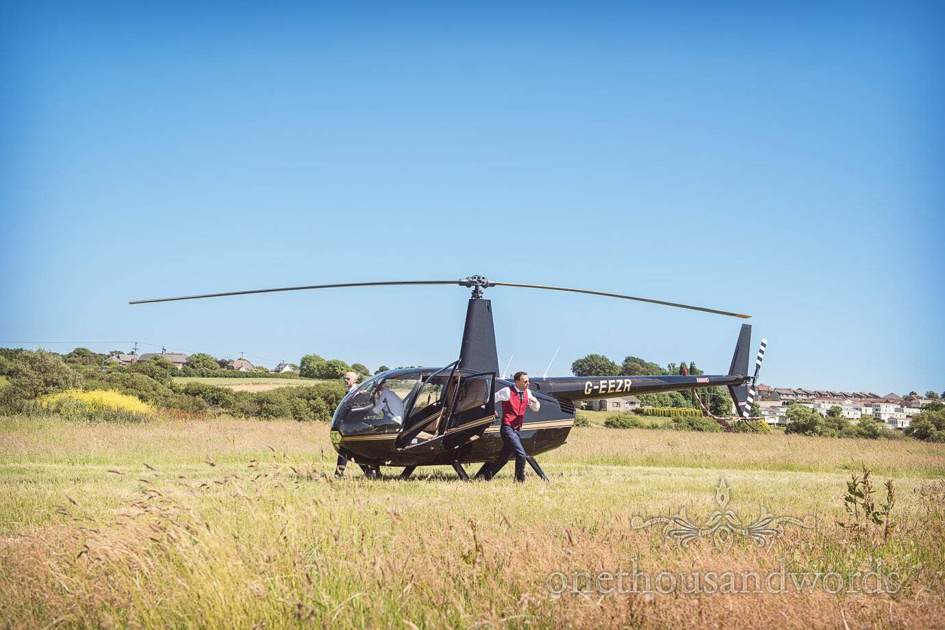Grooms dramatically exit wedding helicopter in Swanage countryside field