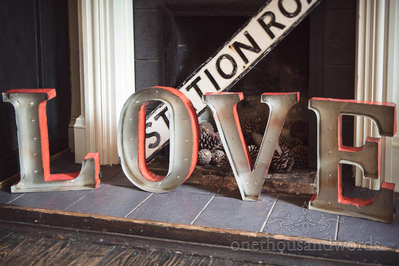 Metal love sign in fireplace at The Old Vicarage Wedding venue bar