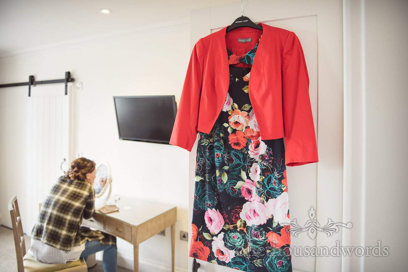 Mother of the bride floral dress with red jacket with bride styling wedding make up