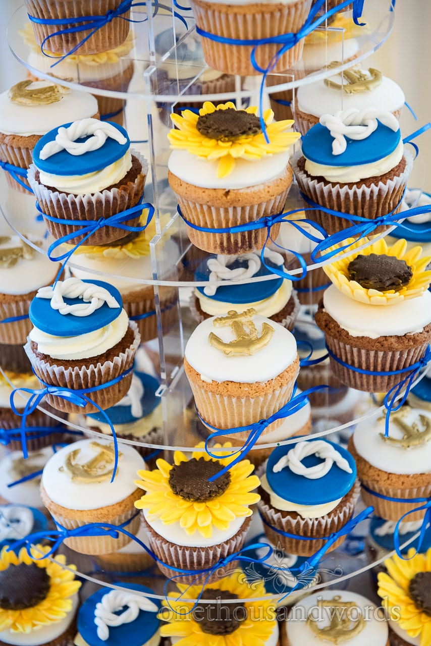 Nautical themed wedding cup cakes with anchors, rope knots and sunflowers