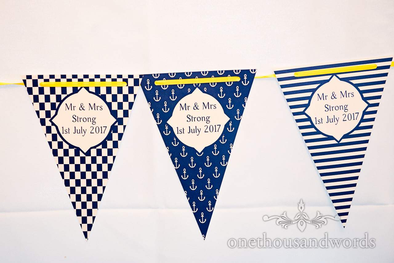 Nautical themed wedding flag bunting with blue and yellow theme