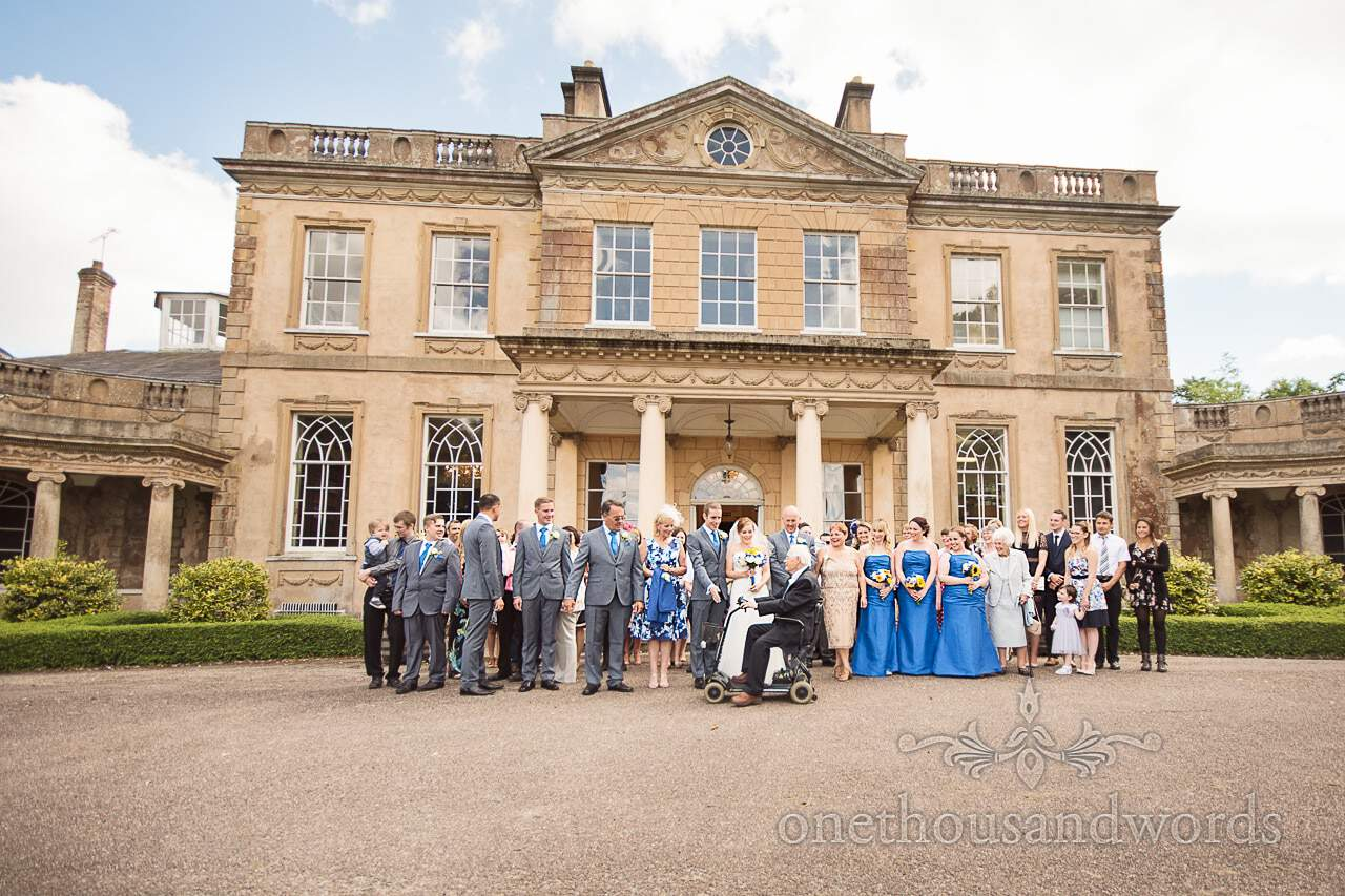 Old man on mobility scooter photo-bombs group wedding photograph at Upton House