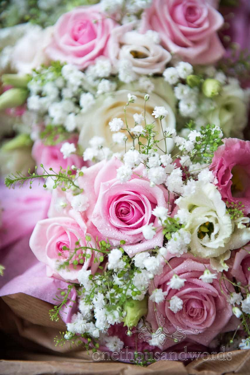 Pink and white wedding rose flowers bouquets photographs with dew drops