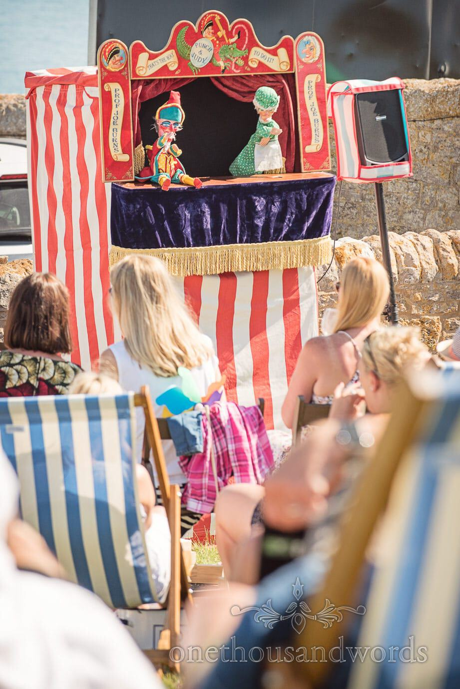 Punch and Judy show at wedding by Swanage Wedding Photographers