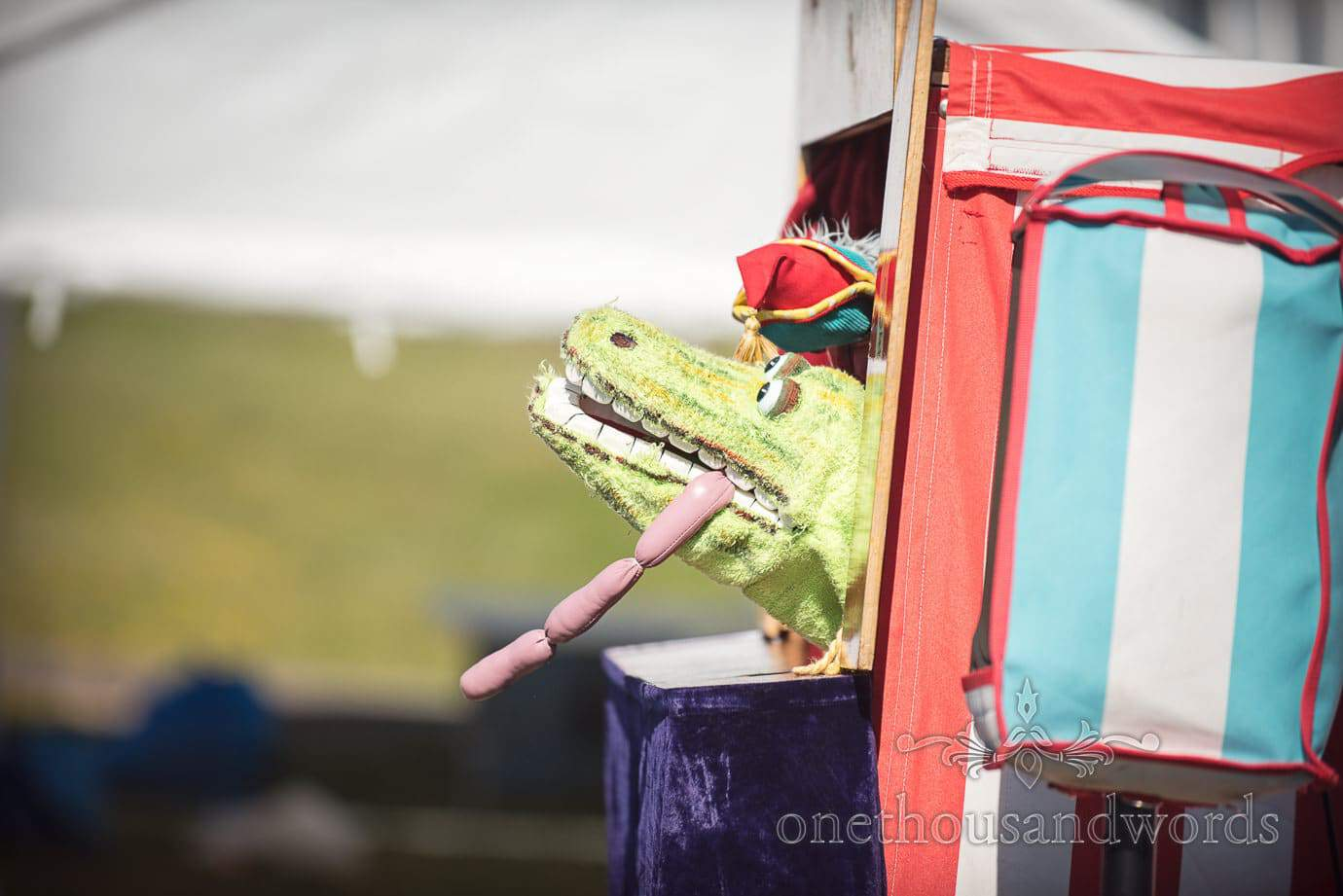 Punch and Judy show with crocodile and sausages by Swanage Wedding Photographers