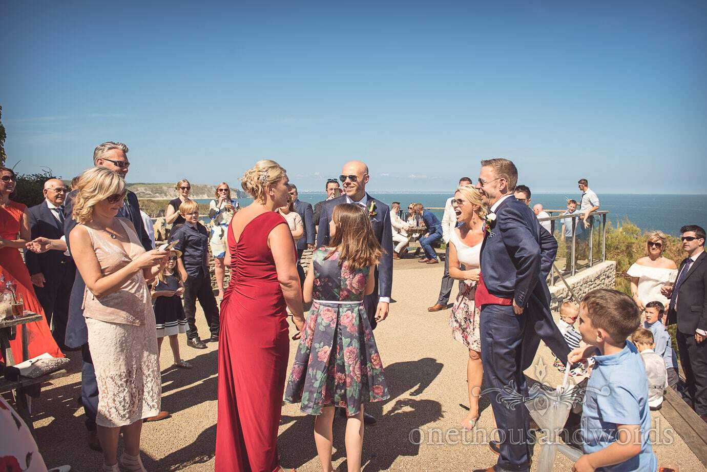 Same sex wedding drinks reception by the sea at Durlston Castle wedding venue