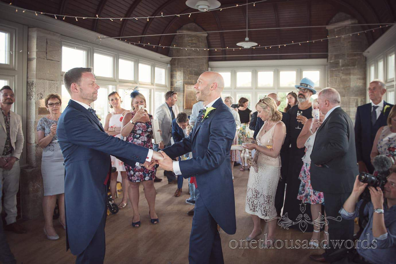Same sex wedding first dance photograph by Swanage wedding photographers at Durlston Castle