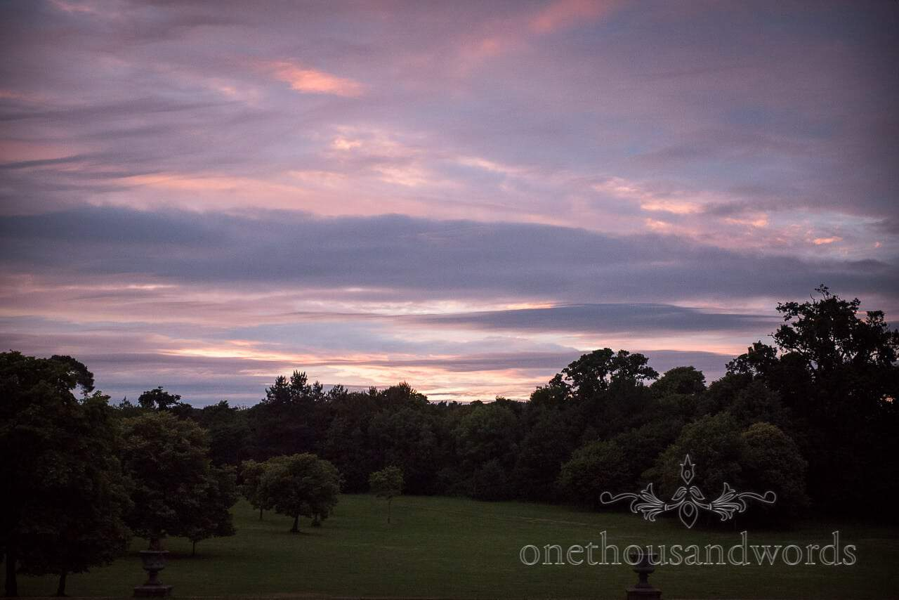 Sunset over the Dorset countryside and trees at Upton House wedding venue