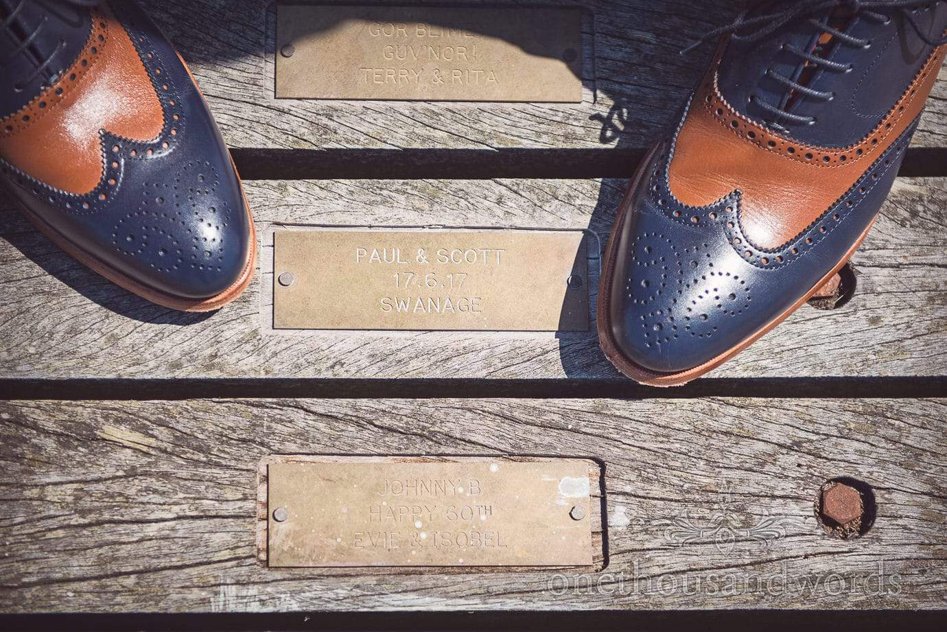 Swanage Pier engraved bras plaque commemorating wedding date with groom's shoes