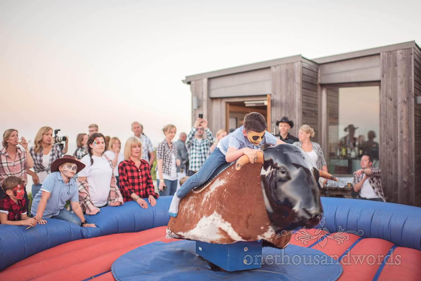 Swanage wedding photographers capture Bucking bronco at cowboy themed wedding