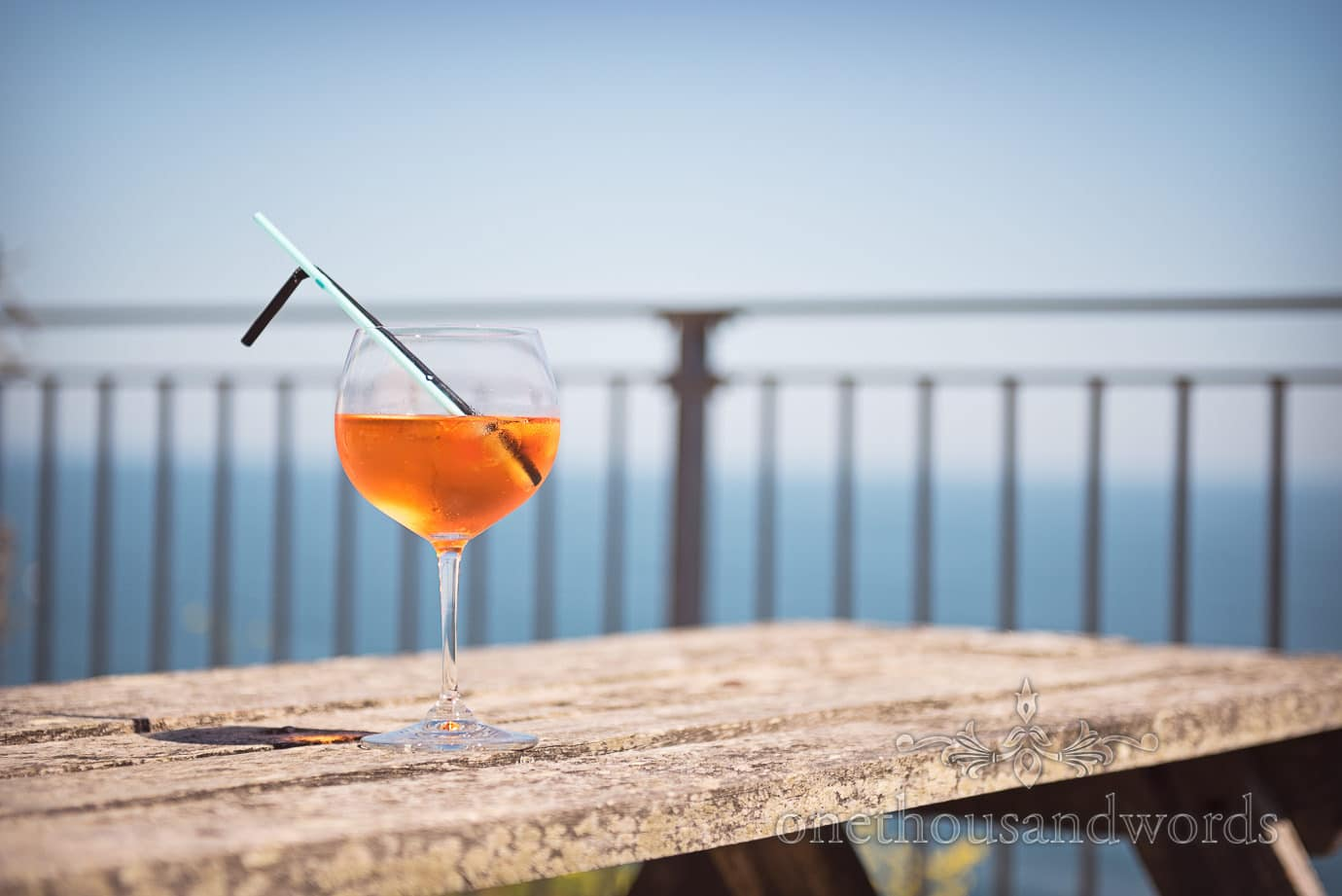 Swanage Wedding Photographers capture cocktail wedding drink by the sea in Dorset