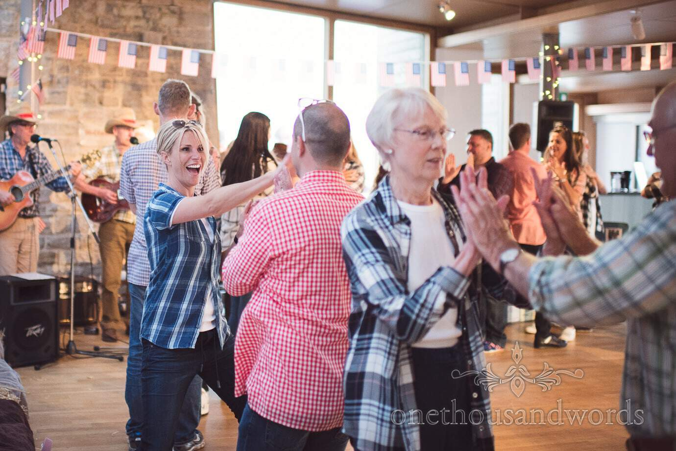 Swanage Wedding Photographers capture cowboy themed wedding barn dance in Castle