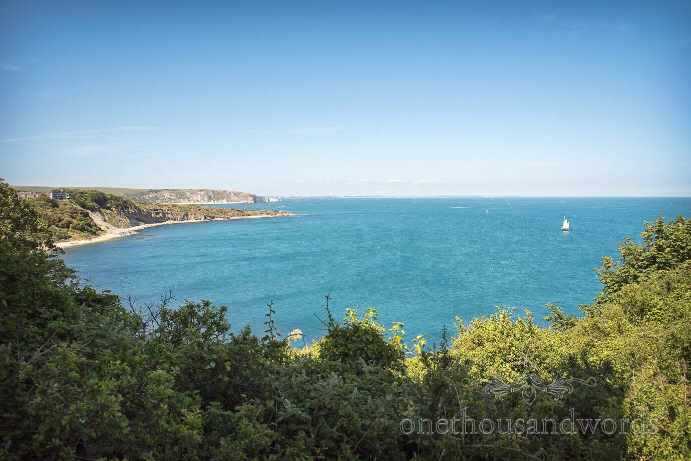 Swanage Wedding Photographers capture sea and coastal views from Durlston castle wedding venue