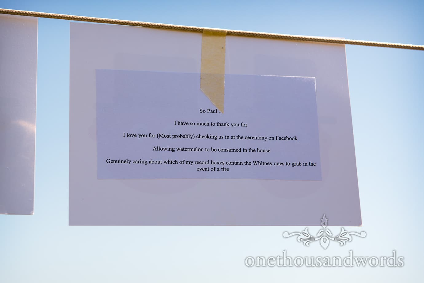 Swanage Wedding Photographers capture wedding speech card hanging from washing line