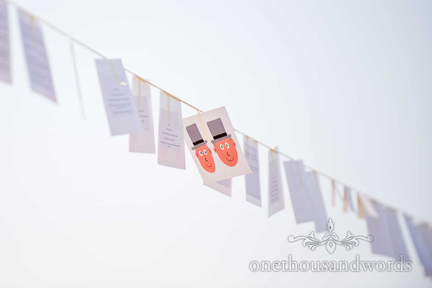 Swanage Wedding Photographers capture wedding speech cards hanging on washing line