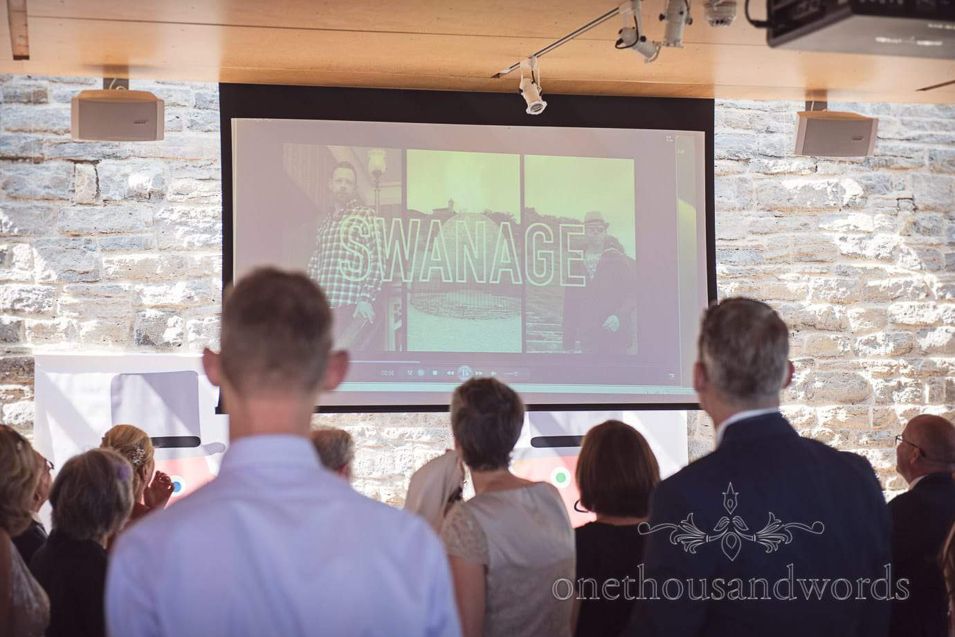 Swanage Wedding Photographers capture wedding video projection in Durlston Castle
