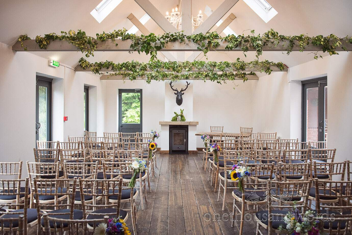 The Old Vicarage Wedding ceremony set up in The Orangery with sunflowers and ivy