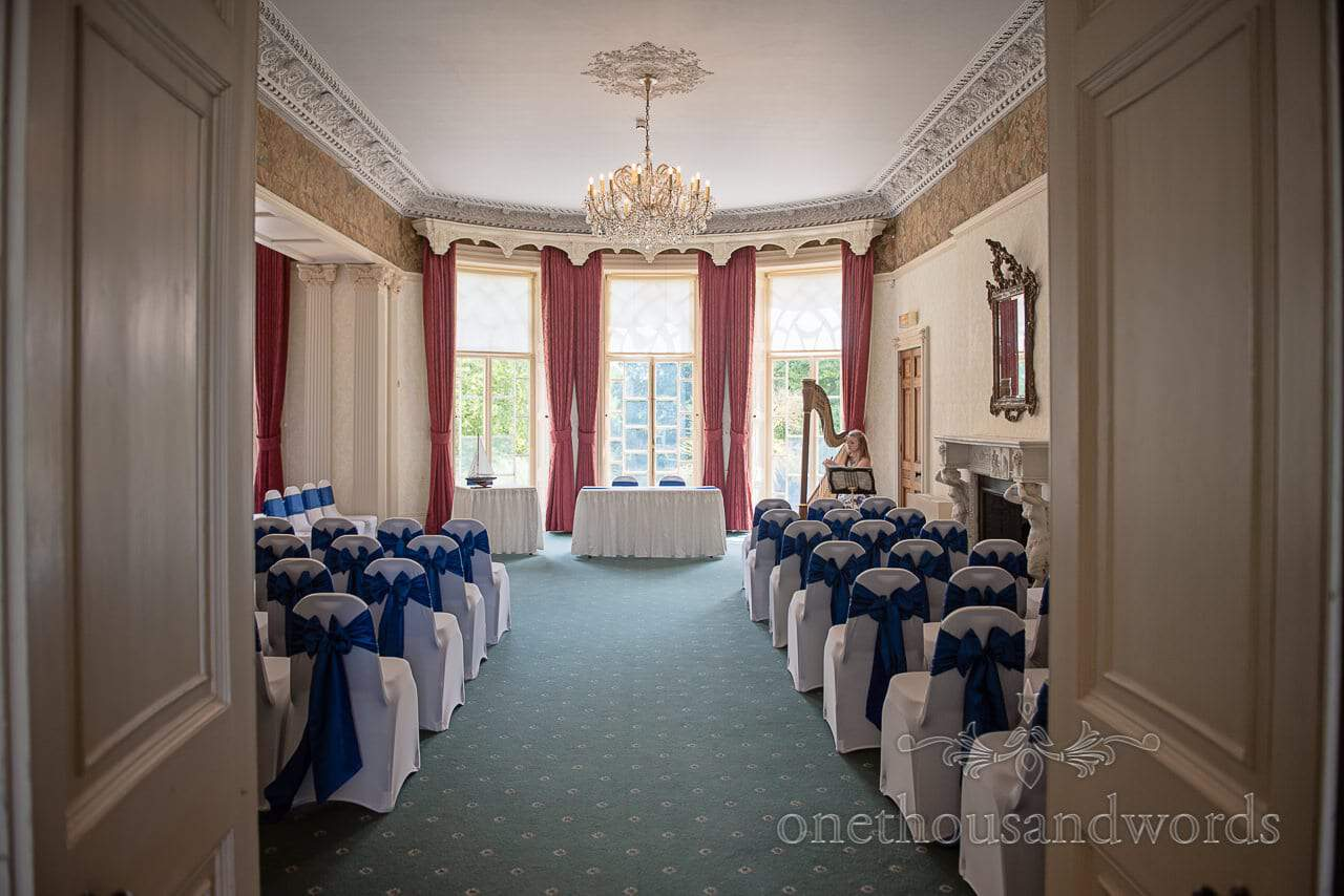 Upton House, Dorset wedding ceremony room set up with blue chair sashes