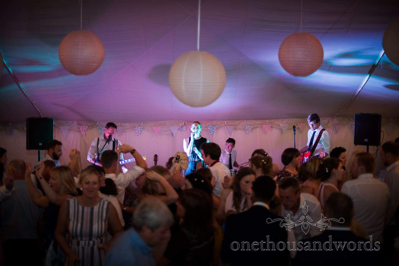Wedding band plays to marquee full of dancing wedding guests in Dorset