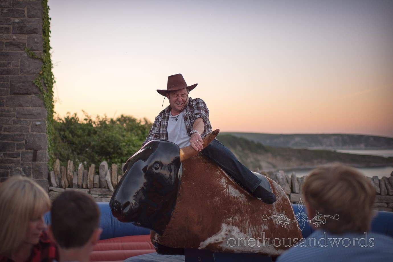 Wedding bucking bronco with sunset at Durlston Castle wedding venue