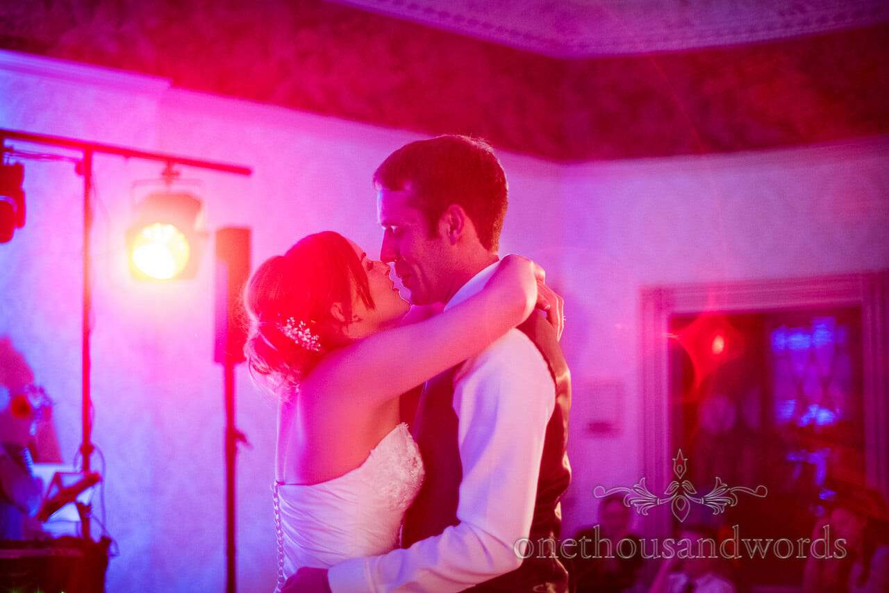 Wedding first dance with red disco lights at Upton House wedding