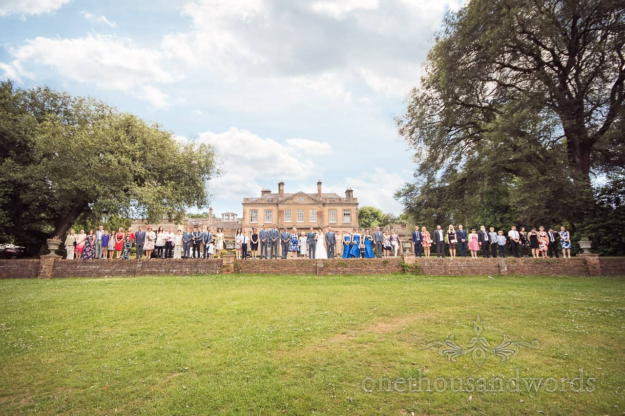 Wedding group photograph on the ha-ha at Upton Country House wedding venue in Dorset
