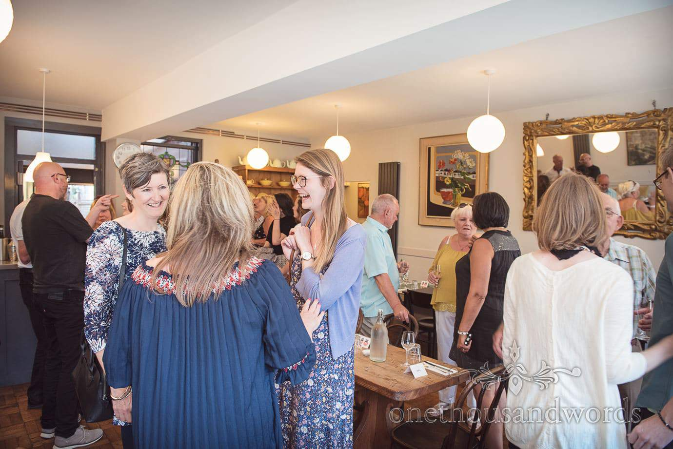 Wedding guest enjoy drinks at pre-wedding party in Swanage restaurant