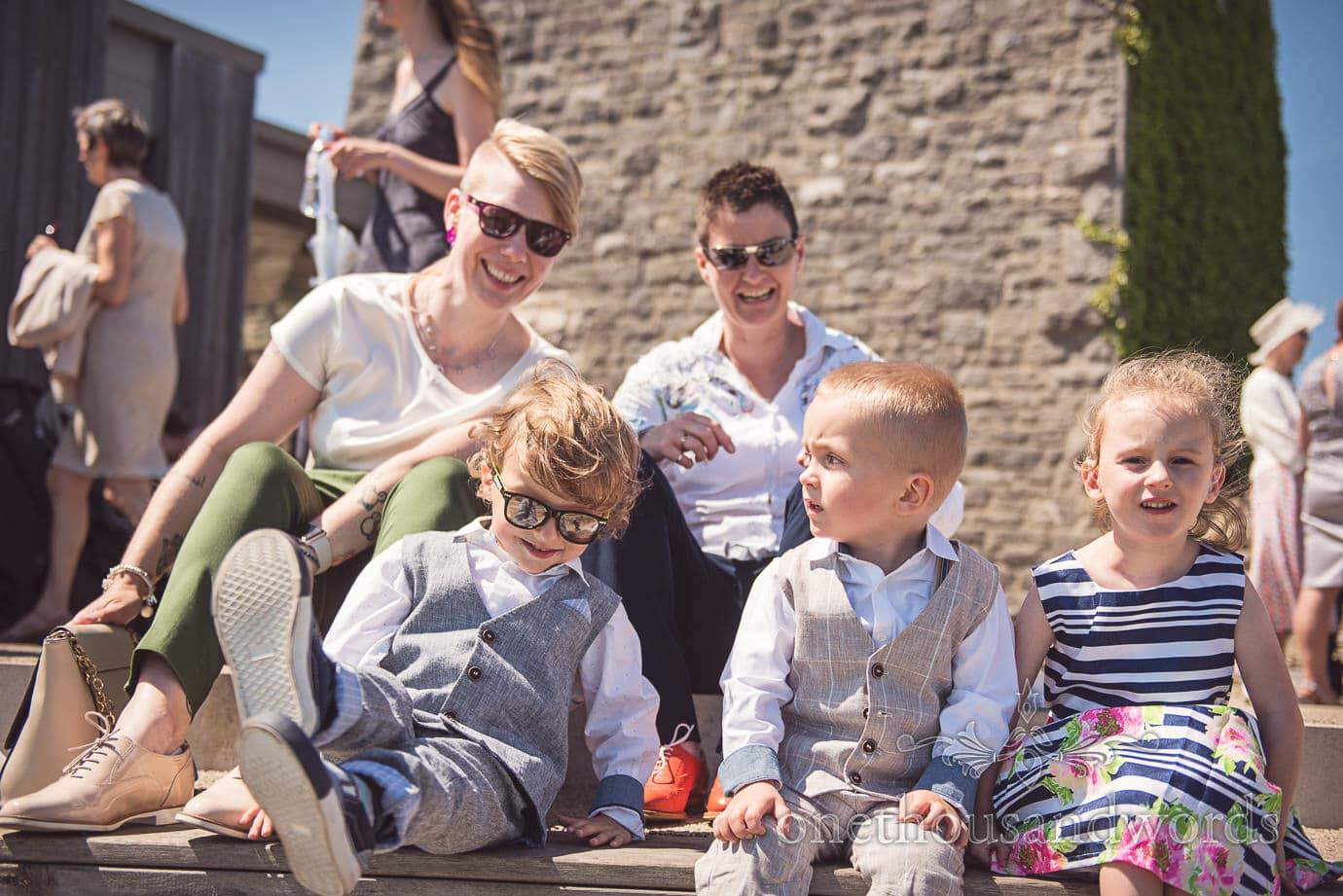 Wedding guest family group enjoying the summer sun at Durlston Castle wedding