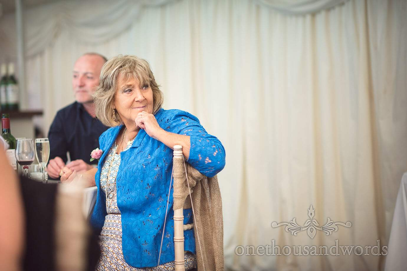 Wedding guest in blue jacket listens intently to speeches at The Old Vicarage Wedding