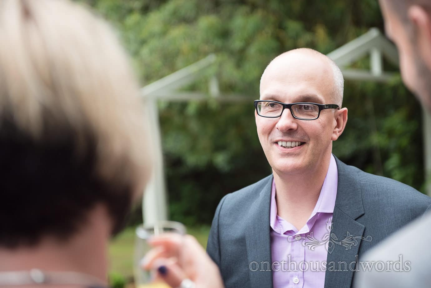 Wedding guest in glasses at The Old Vicarage Wedding drinks reception