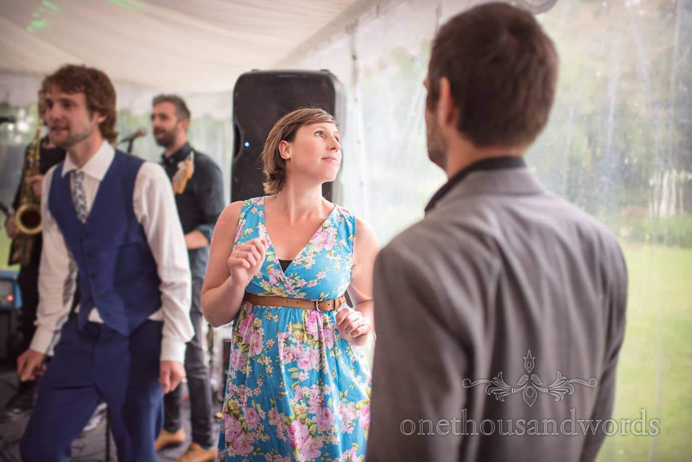 Wedding guest in light blue retro floral dress dancing at The Old Vicarage Wedding