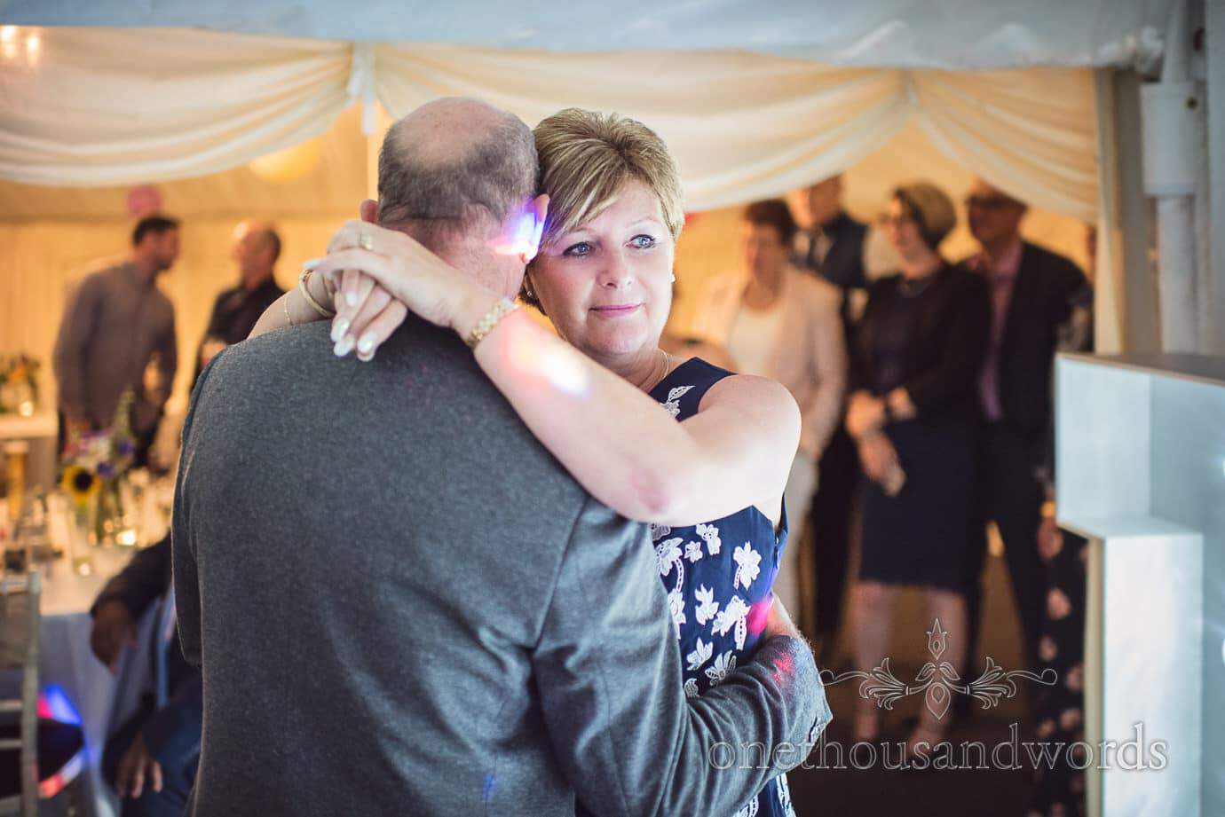 Wedding guest watches wedding band as she slow dances at The Old Vicarage Wedding