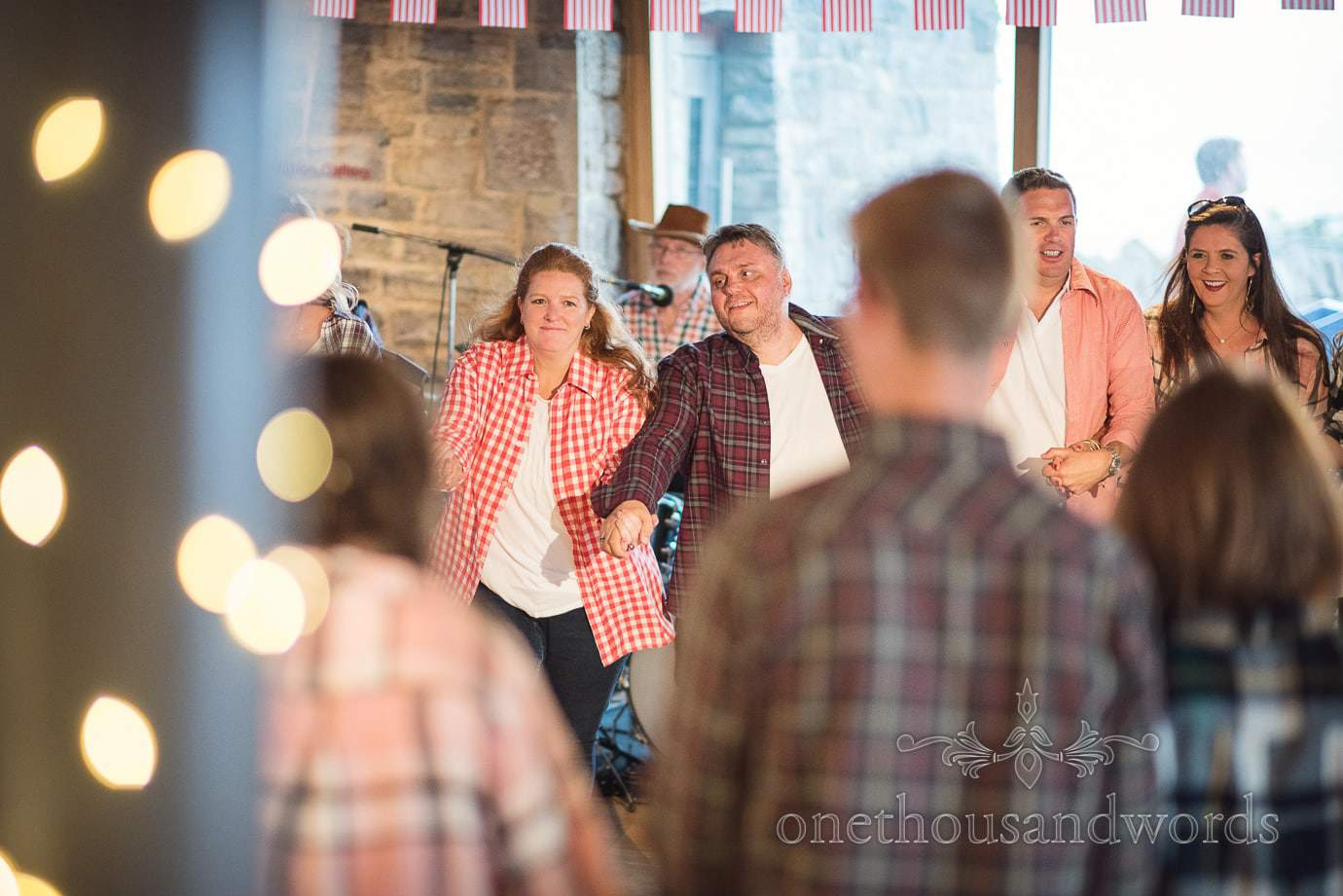 Wedding guests enjoy barn dance at Durlston Castle wedding venue in Swanage, Dorset