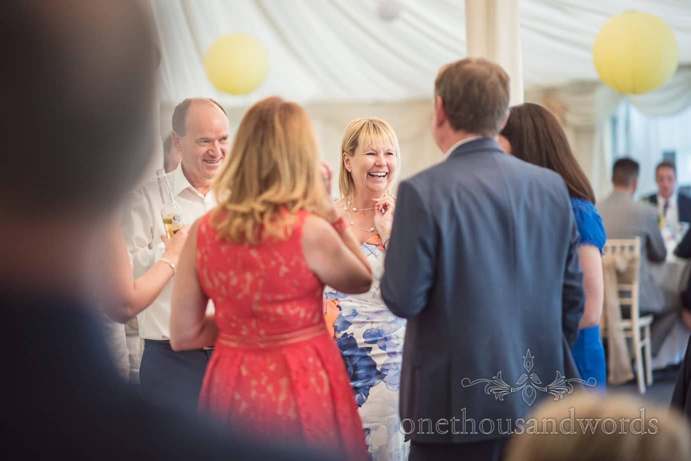 Wedding guests laughing in wedding marquee at The Old Vicarage Wedding venue