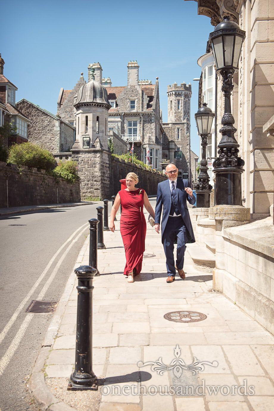 Wedding guests walk from Purbeck House Hotel wedding venue in Swanage
