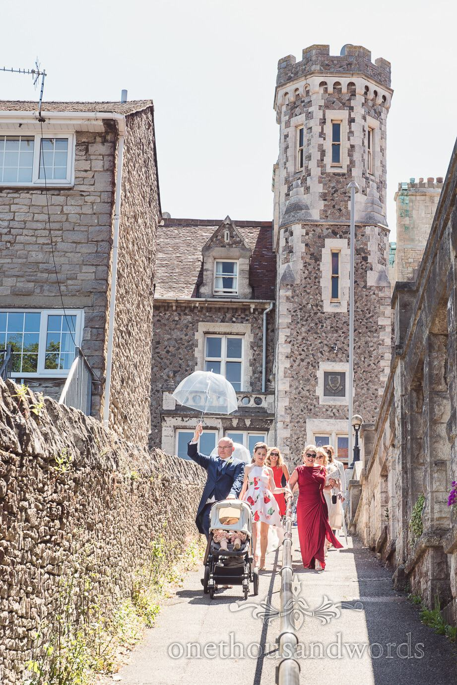 Wedding guests walk to beach from Purbeck House Hotel wedding venue in Swanage