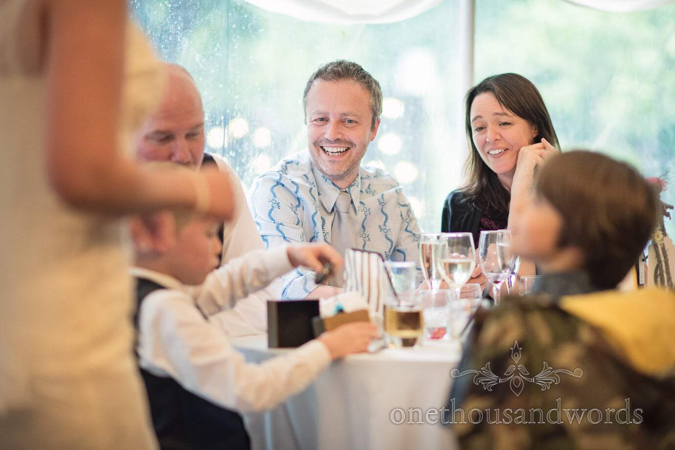 Wedding guests watch son receive wedding gift at The Old Vicarage Wedding